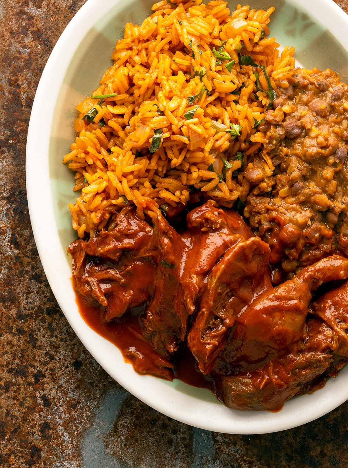 Closeup of the platter of rice, beans and carne con chile.