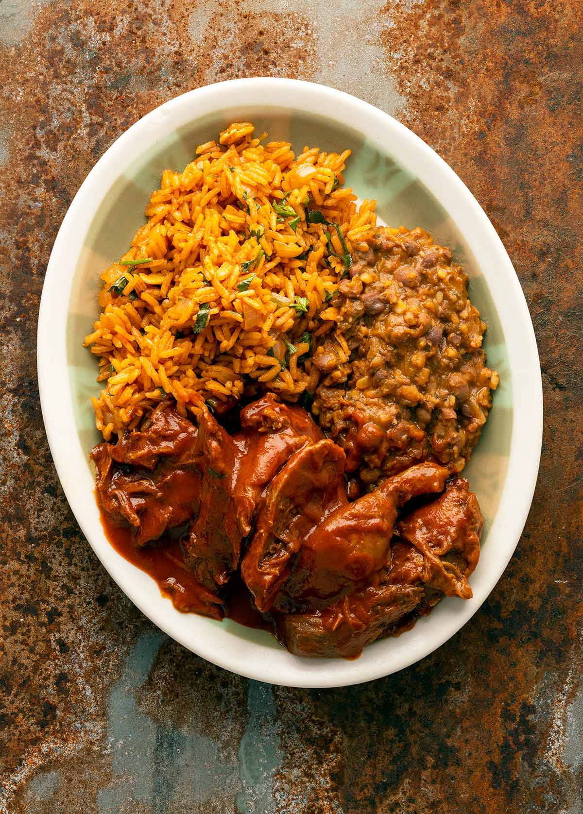 Sonoran carne con chile on a plate with rice and beans