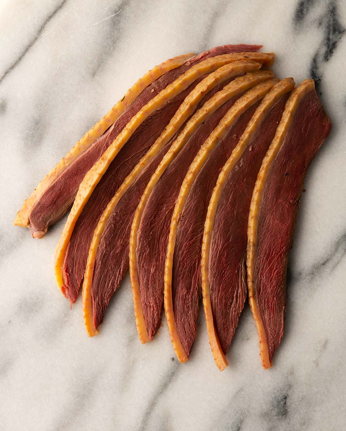 Slices of duck bacon ready to eat
