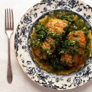 A plate of Spanish green sauce over fish