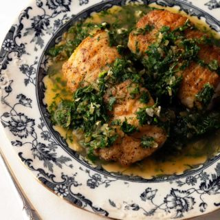 Fish with Spanish green sauce on a plate