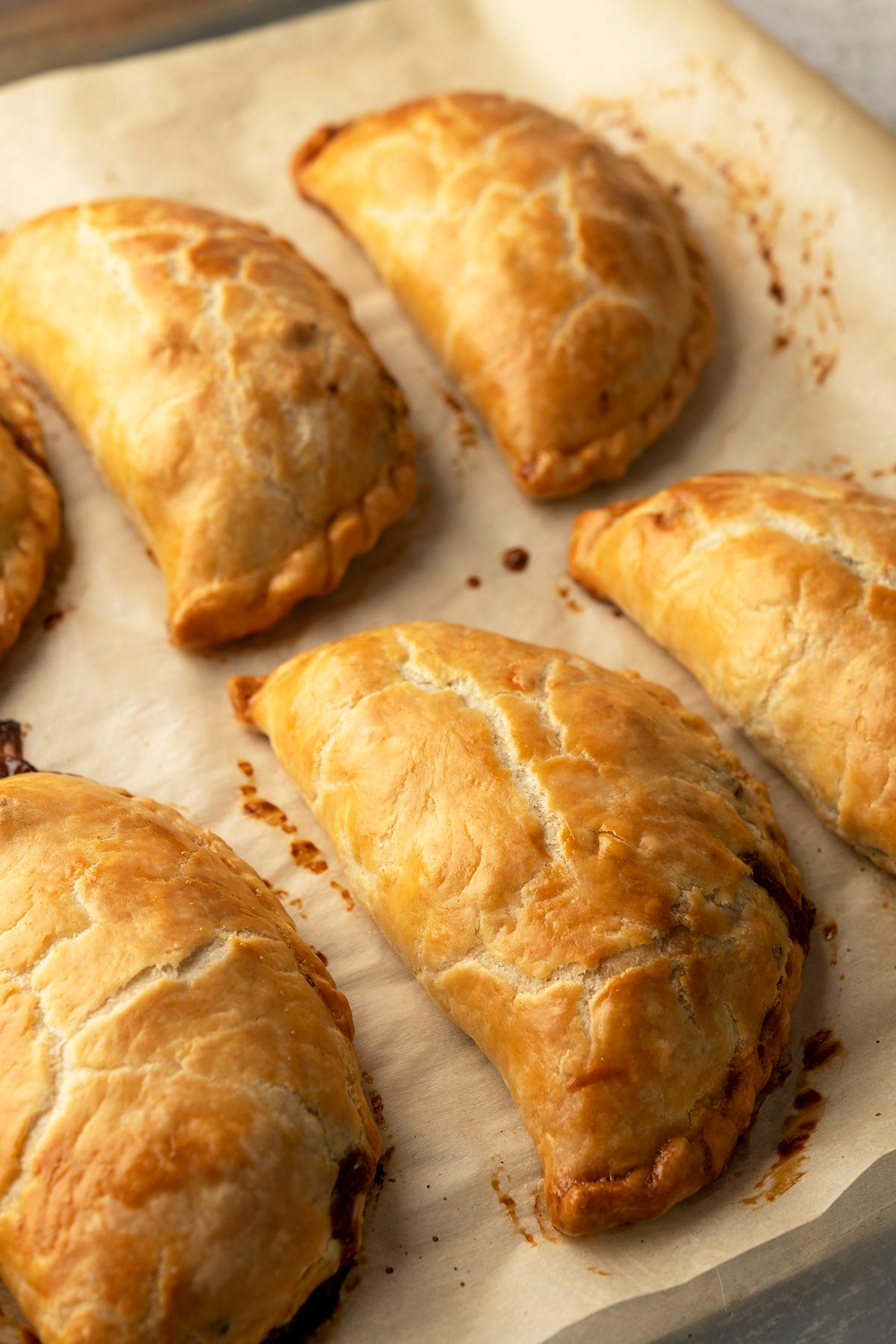 Finished pasty recipe, with pasties cooling on parchment paper
