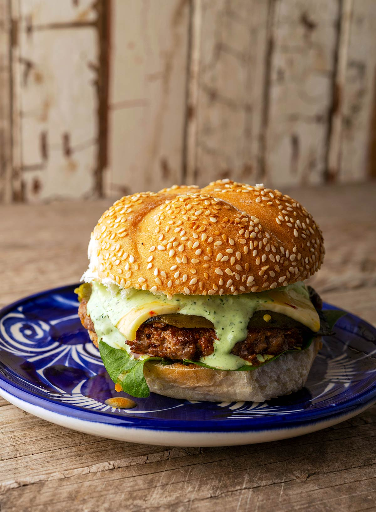 A chorizo burger on a plate, ready to eat.