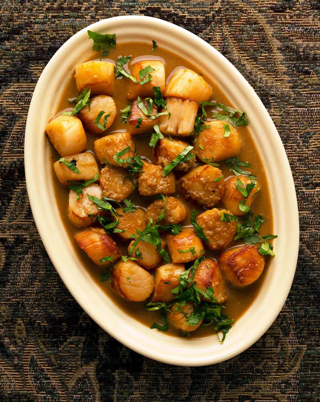 garlic butter scallops on a platter