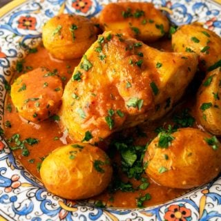 Closeup of Catalan monkfish on a plate with potatoes