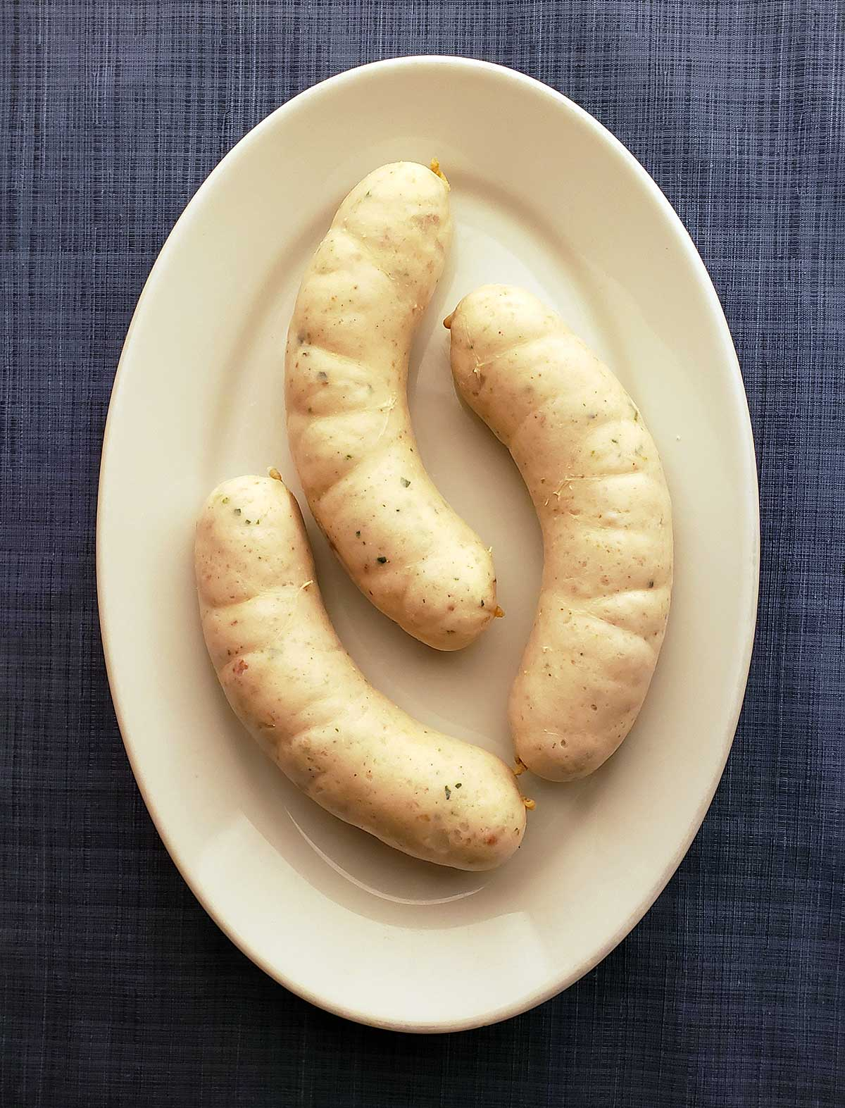 Three links of weisswurst on a plate