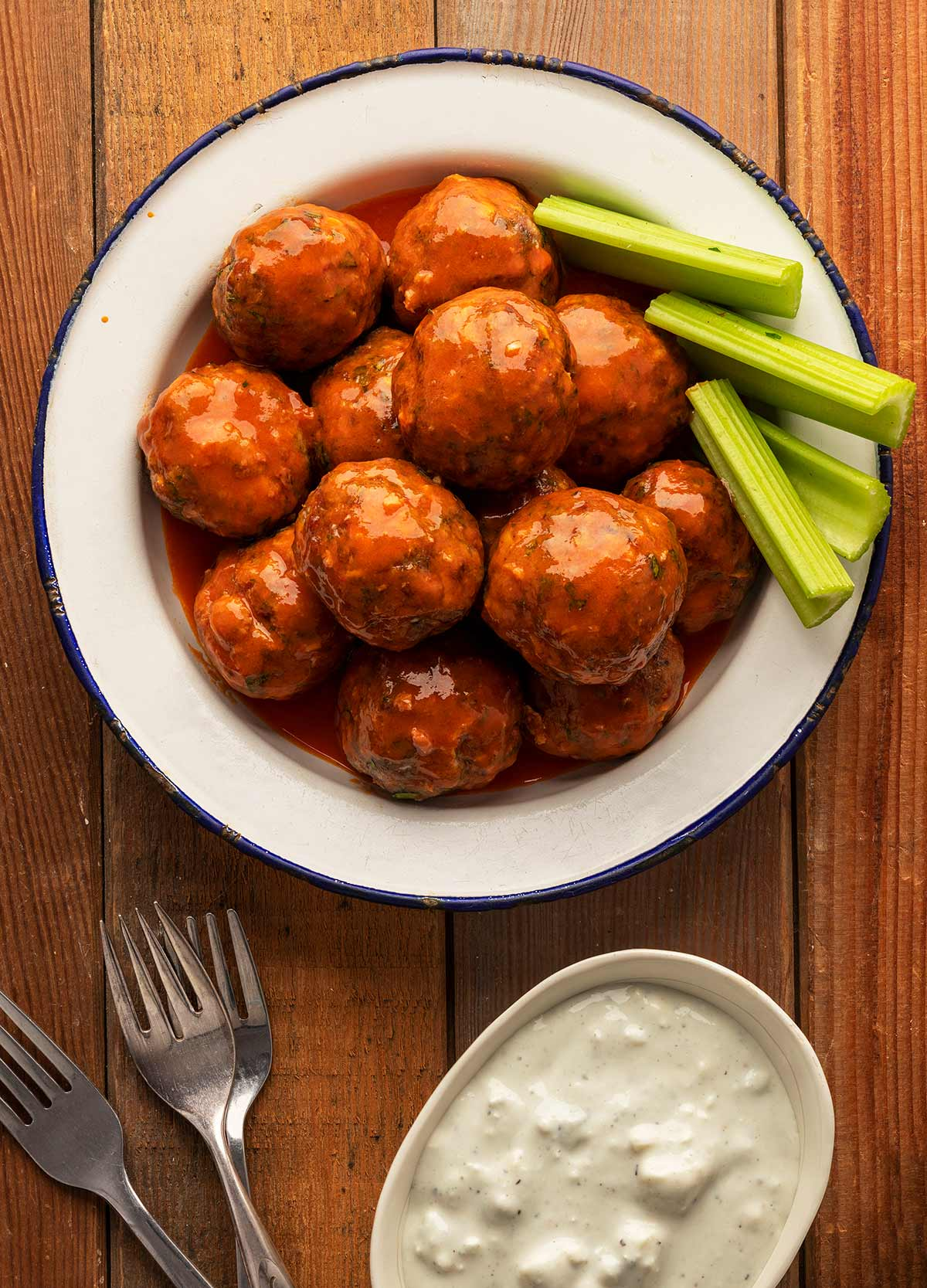 A plate of Buffalo meatballs with blue cheese sauce.