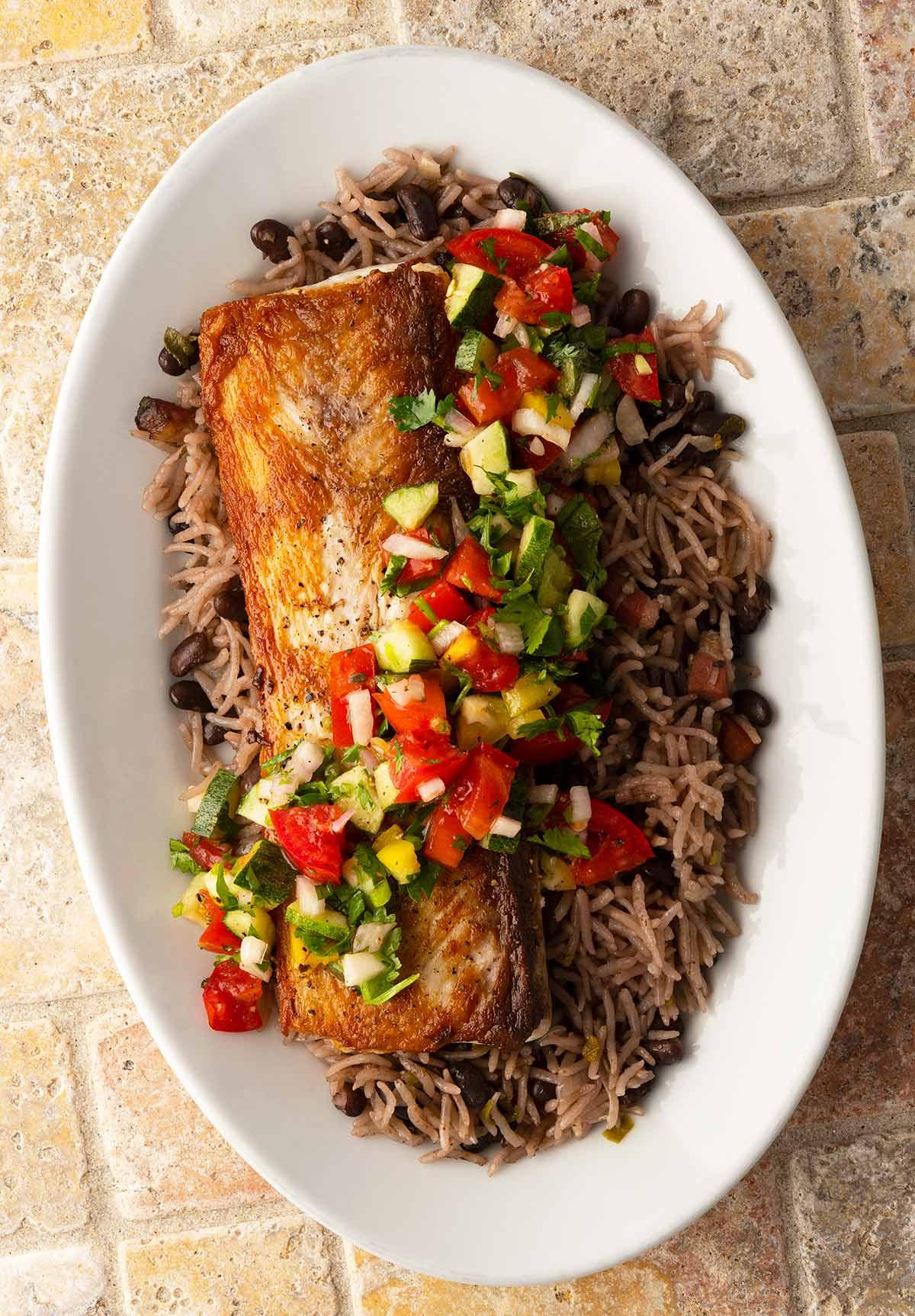 Pan seared mahi mahi with rice and salsa