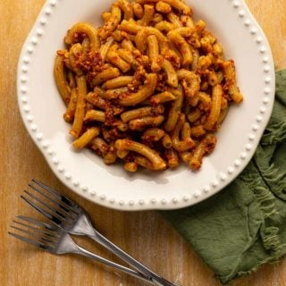 A bowl of pasta dressed with red pesto