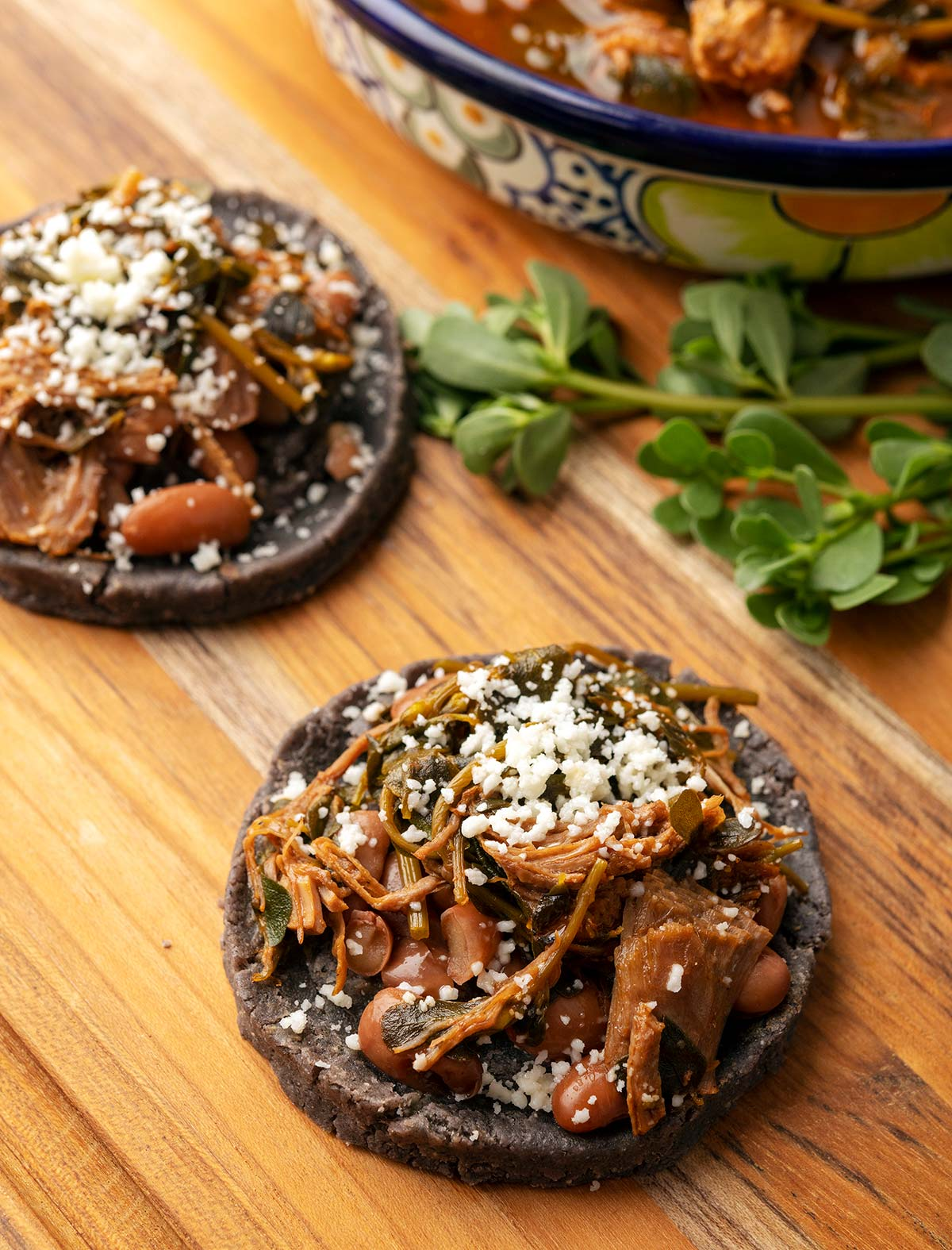 Homemade sopes filled with pork and purslane