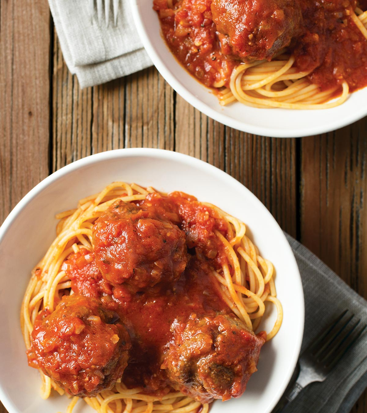 Two bowls of venison meatballs with spaghetti
